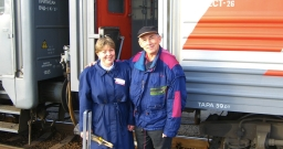 A Provodnitsa looking after one of her passengers on The Trans-Siberian Railway